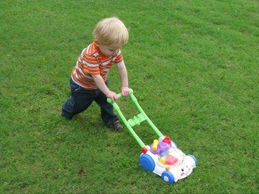 Caleb mowing